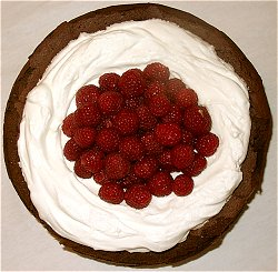Flourless Chocolate Cake with Whipped Cream and Raspberries